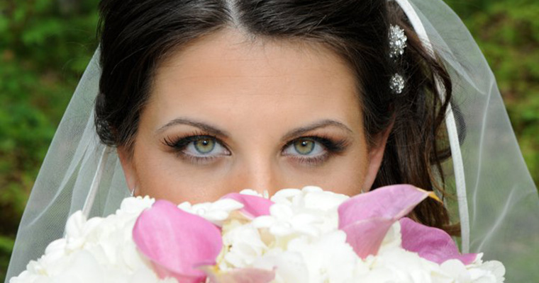 bride looking over bouquet of flowers