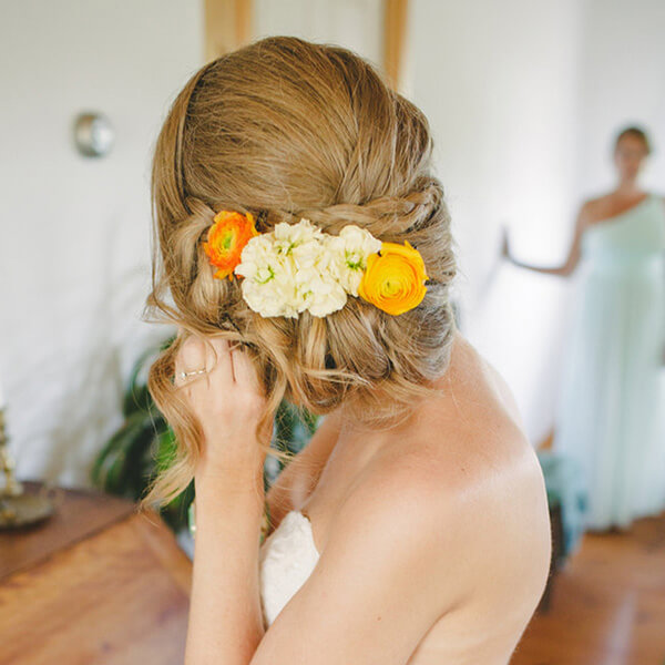 flowers in a brides hairstyle