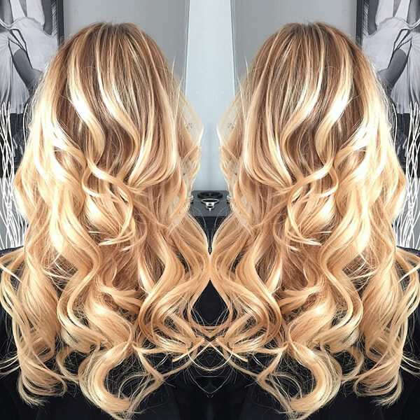 mirror image of a long, curly hairstyle