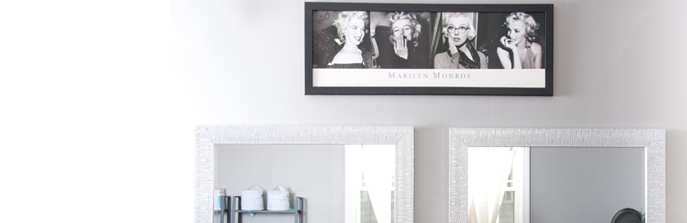 detail of wall with mirrors and marilyn monroe photos